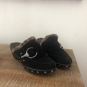 Comfy cozy Stuart Weizmann black clogs